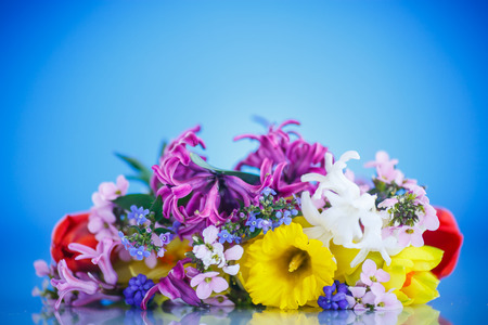 text pink: beautiful bouquet of spring flowers on a blue background