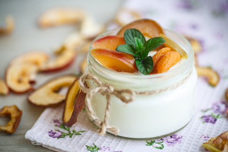 home cooked: home sweet yogurt with dried fruit cooked in a glass jar Stock Photo