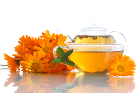 Herbal tea with marigold flowers on a white background photo