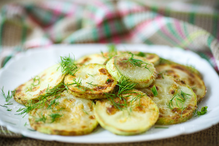 seasoned: fried zucchini seasoned with dill in a bowl