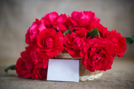 your text: beautiful bouquet of red roses in basket