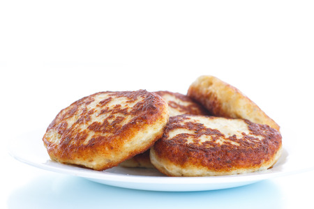 cooked fish: Fish fried patties on a plate on a white background Stock Photo