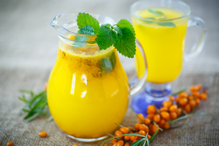 seabuckthorn: juice from ripe sea-buckthorn berries in glass cup