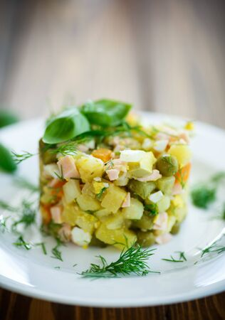 the greens: vegetable salad with pickled cucumbers and greens
