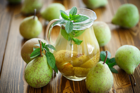 decanter: sweet pear compote in a decanter on a wooden table