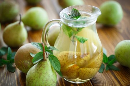 compote: sweet pear compote in a decanter on a wooden table