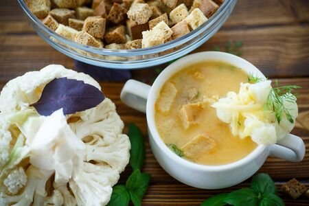 pureed: soup pureed cauliflower in a plate on the table Stock Photo