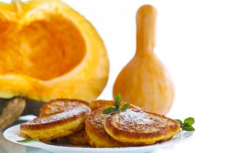fucking: fried sweet pumpkin pancakes on a white background