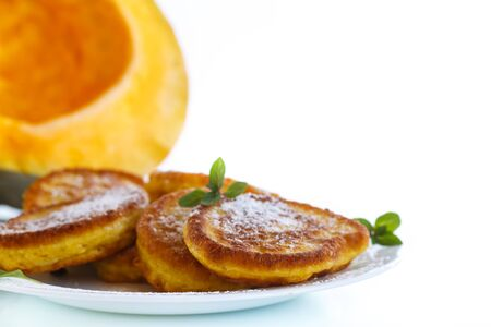 fucking: fried sweet pumpkin pancakes on a white background