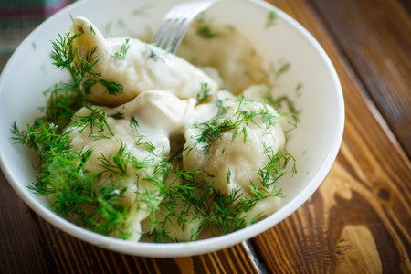 sour cream: boiled dumplings with sour cream and dill