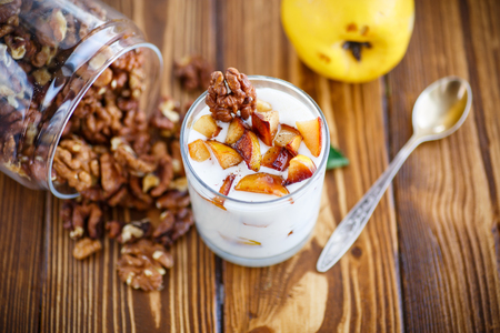 fillers: sweet yogurt with baked quince in a glass Stock Photo
