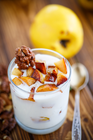 quinces: sweet yogurt with baked quince in a glass Stock Photo