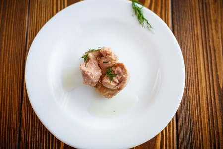 delikatesse: piece of cod liver on a white plate