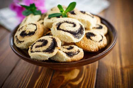 crumbly: delicious crumbly biscuits with poppy seeds on a table Stock Photo