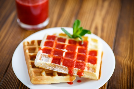 viennese: Viennese sweet waffles with strawberry jam on the table Stock Photo