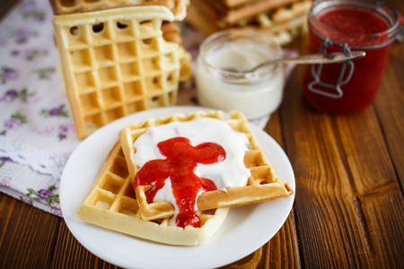 viennese: Viennese waffles with yogurt and strawberry jam on the table Stock Photo