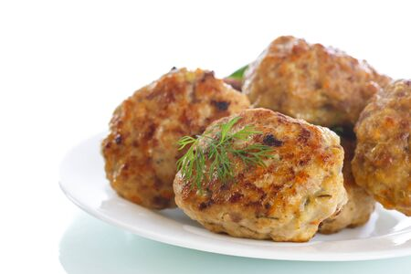 baked meat: fried meatballs with herbs on white background