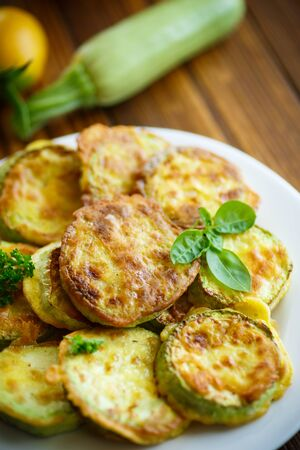 batter: zucchini fried in batter on a wooden table