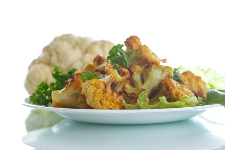 meatless: cauliflower baked in batter on a white background