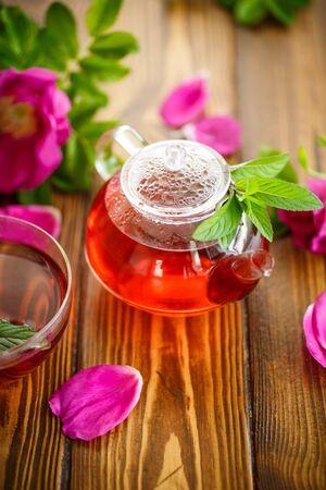 fresh tea with rosehip on a table