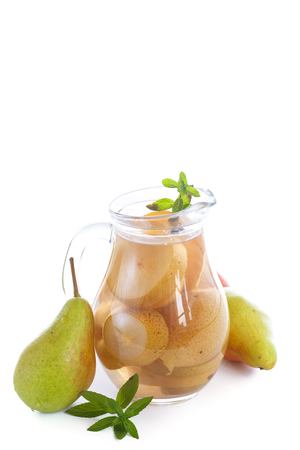 sweet pear compote in a decanter on a white background Stock Photo