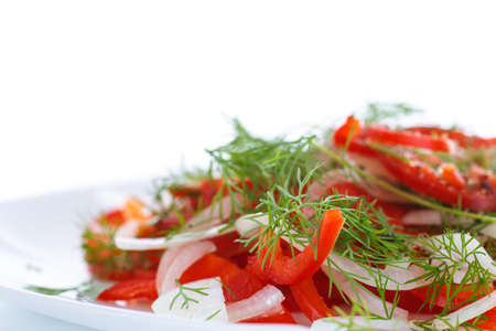fresh salad with fresh peppers and onions on a white background