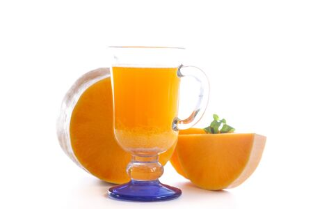 Fresh pumpkin juice in a glass on a white background Stock Photo