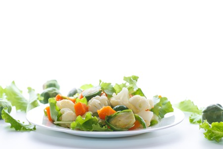 salad of lettuce, cauliflower and Brussels sprouts with a pumpkin on a plate