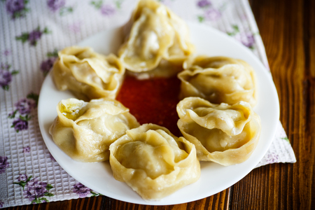 Traditional boiled manti in a plate