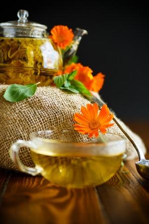 Therapeutic tea from flowers of calendula Stock Photo