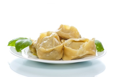 Boiled manti with meat on a plate Stock Photo