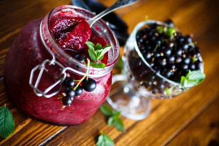 Berry ripe black currant with jam Stock Photo