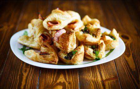 Baked puff pastry with bacon Stock Photo