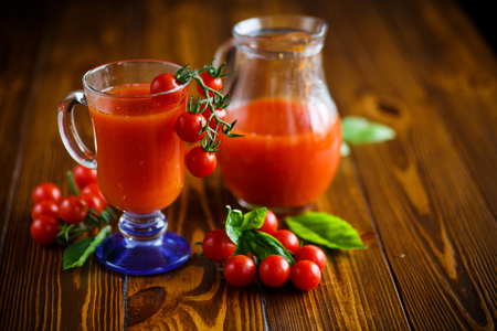 Homemade natural tomato juice in a decanter Stock Photo