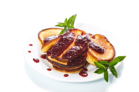 desk: sweet pancakes with raspberry jam Stock Photo