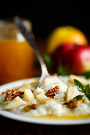 sweet milk oatmeal with apples, nuts and honey Stock Photo