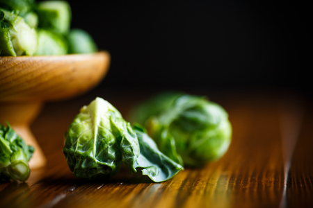 Brussels sprouts close-up on a wooden table