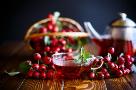 rose hip tea on a wooden background