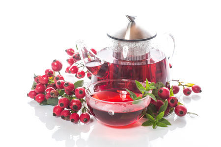 rose hip tea on a white background