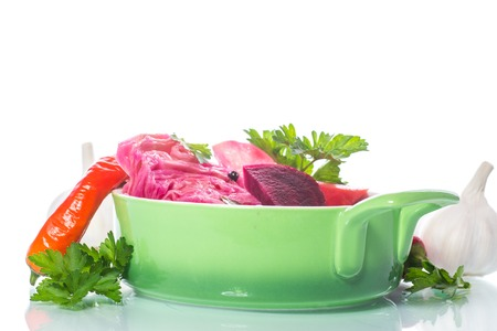 Marinated cabbage with beets and other vegetables on a white background Stock Photo