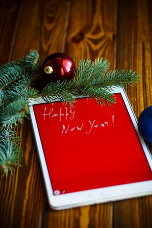 タブレットで新年おめでとう 写真素材