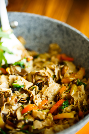 Buckwheat homemade noodles with fried mushrooms and vegetables