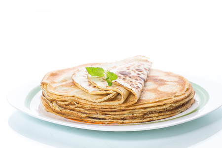 thin delicious pancakes in a plate Foto de archivo