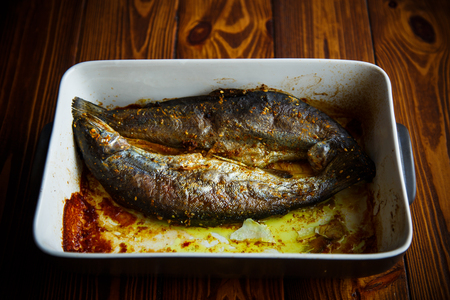 fish baked in ceramic form Stock Photo