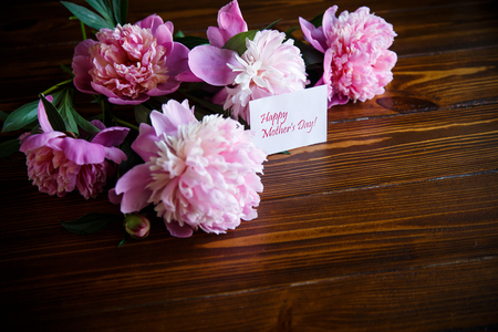 bouquet of blooming peonies on a wooden table