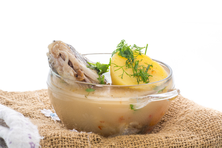 vegetable soup with fish in a glass bowl on a white background Standard-Bild