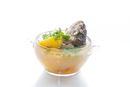vegetable soup with fish in a glass bowl
