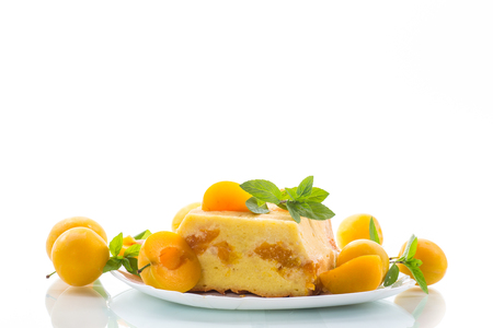 sweet curd casserole stuffed with yellow plums inside Stock Photo