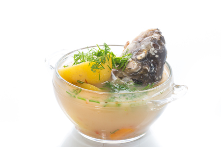 vegetable soup with fish in a glass bowl on a wooden table Stock fotó