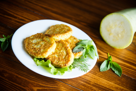 Lenten dietary vegetable fritters with zucchini on a wooden table